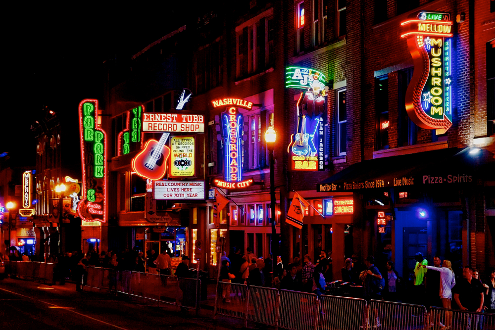 The streets of Nashville Tennessee all lit up at night one of the best honeymoons in the usa