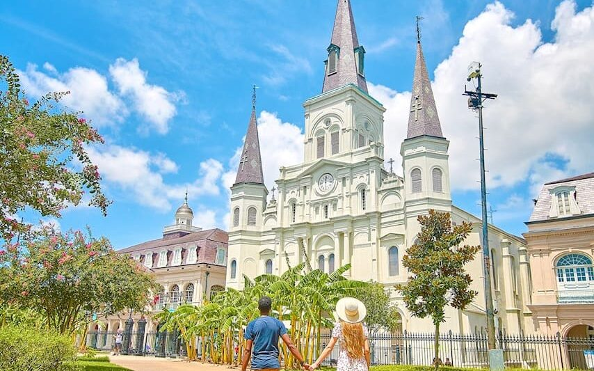 couple standing in Jackson Square New Orleans