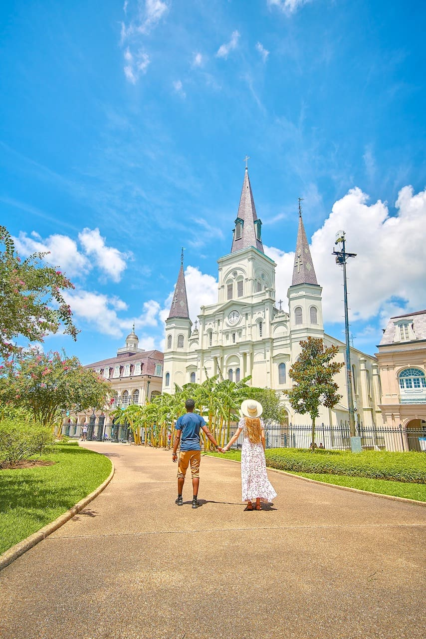 A couple holding hands outside of Jackson Square in New Orleans one of the best honeymoon destinations in the usa