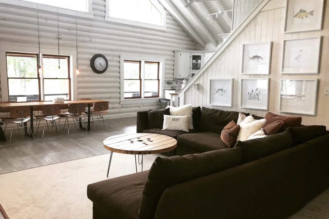 The inside of a cabin that is decorated with a modern Scandinavian style one of the coziest cabins in the South
