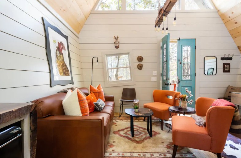 The inside of a charming cabin with purposefully wonky features.