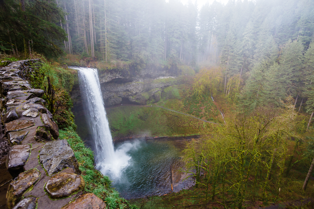 Looking down at one of the many waterfalls on the Trail of Ten Falls in Silver Falls State Park one of the best hikes in the usa