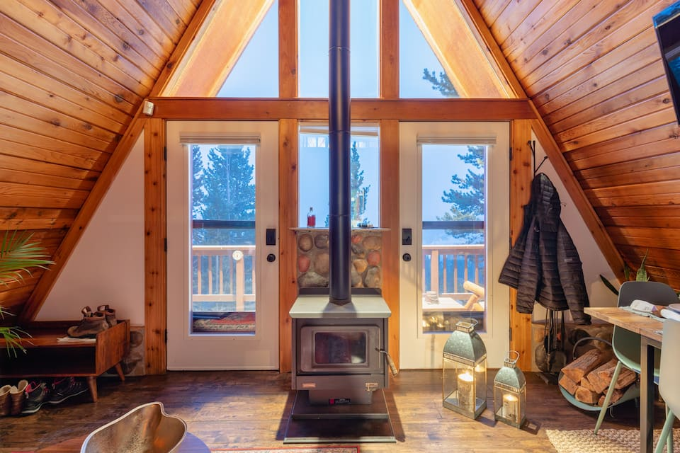 a photo of a charming woodland a-frame, one of the best cabins in denver