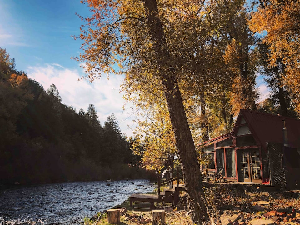 a photo of a waterfront a-frame cabin, one of the coolest cabins in Colorado