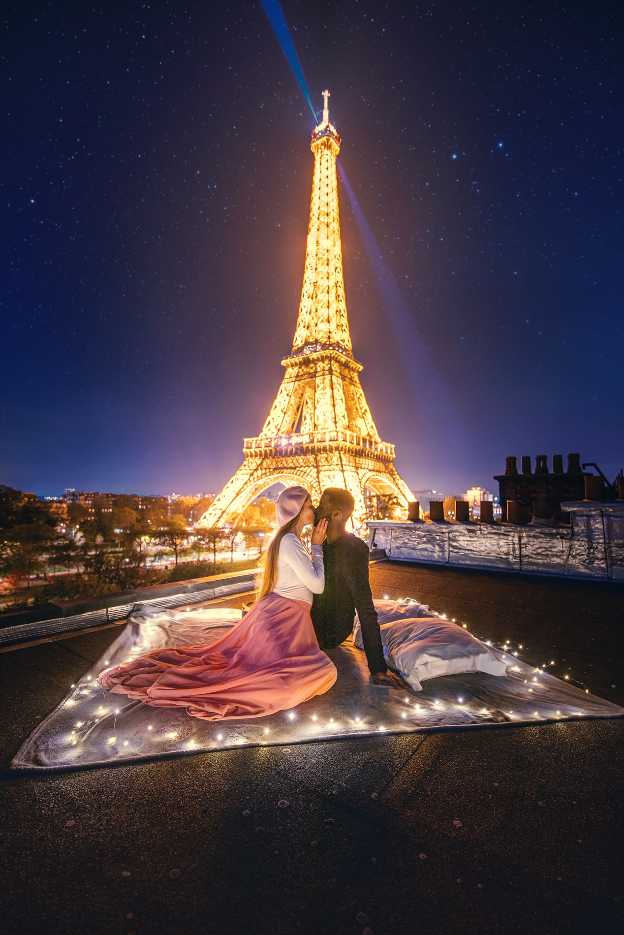 couple on rooftop with Eiffel Tower in back