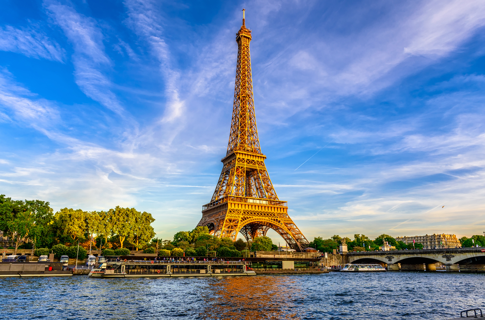 The Eiffel Tower in Paris France on a beautiful day against a bright blue sky