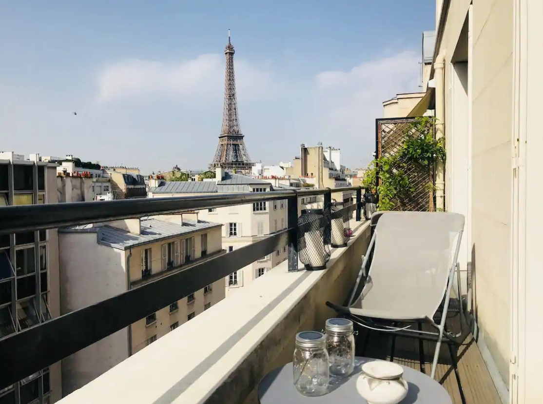 The view of the Eiffel Tower from a private terrace in a small apartment in Paris that also has views of the Paris cityscape