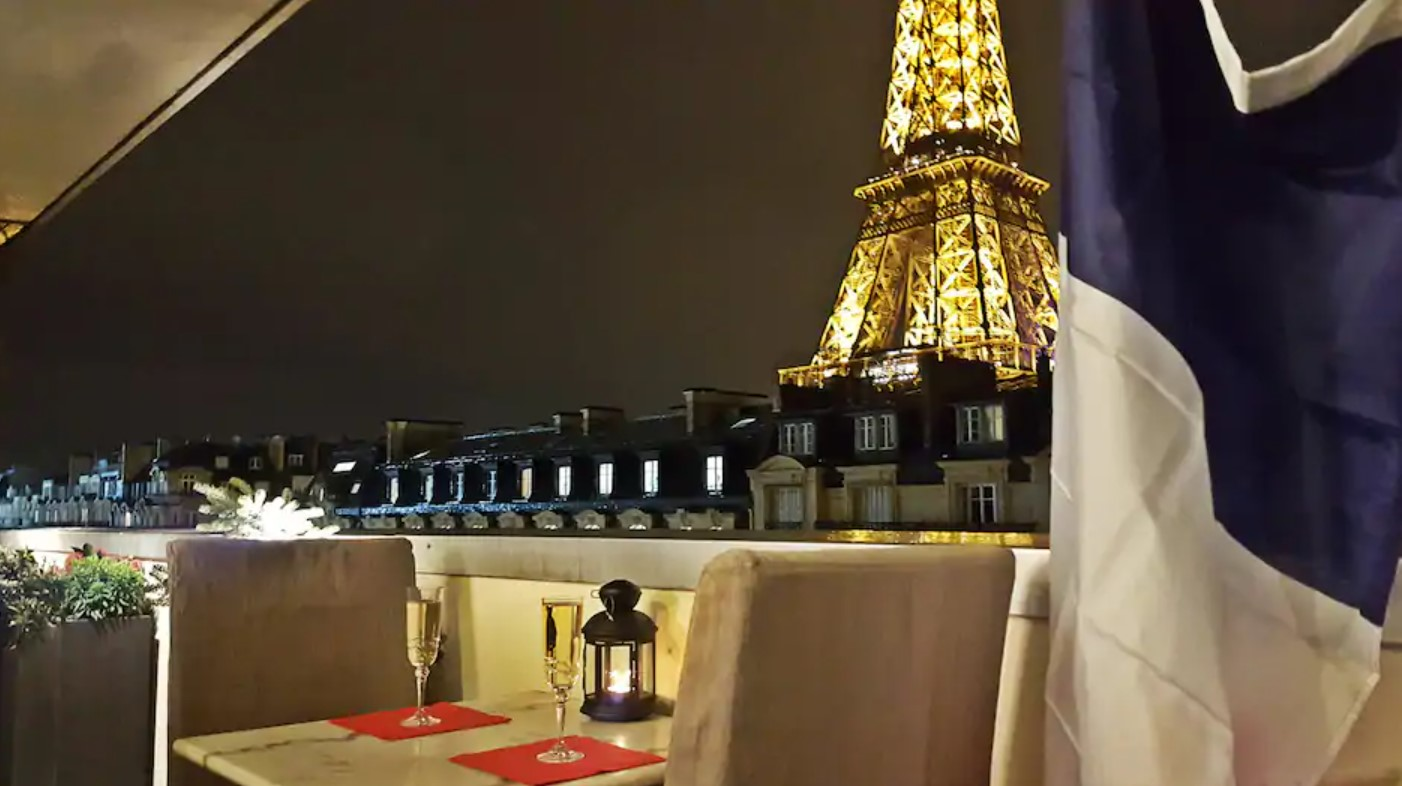 The view of the Eiffel Tower at night from the private balcony in a building at the base of the Eiffel Tower