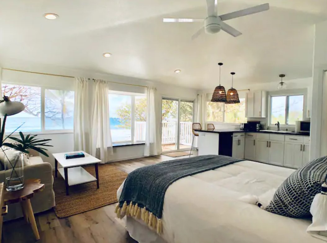 Interior view of a studio that looks out onto the pacific ocean best airbnbs in hawaii