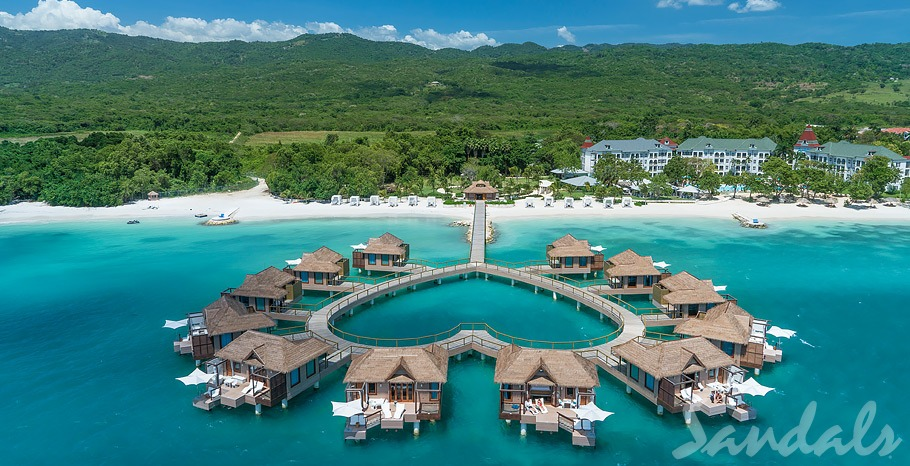 An aerial view of the overwater bungalows in the Caribbean at the Sandals South Coast Resort that are arranged in the shape of a heart