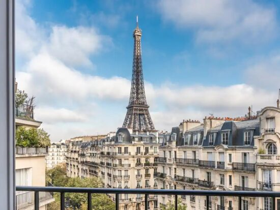 a view of the Eiffel Tower and the streets of Paris from a private balcony