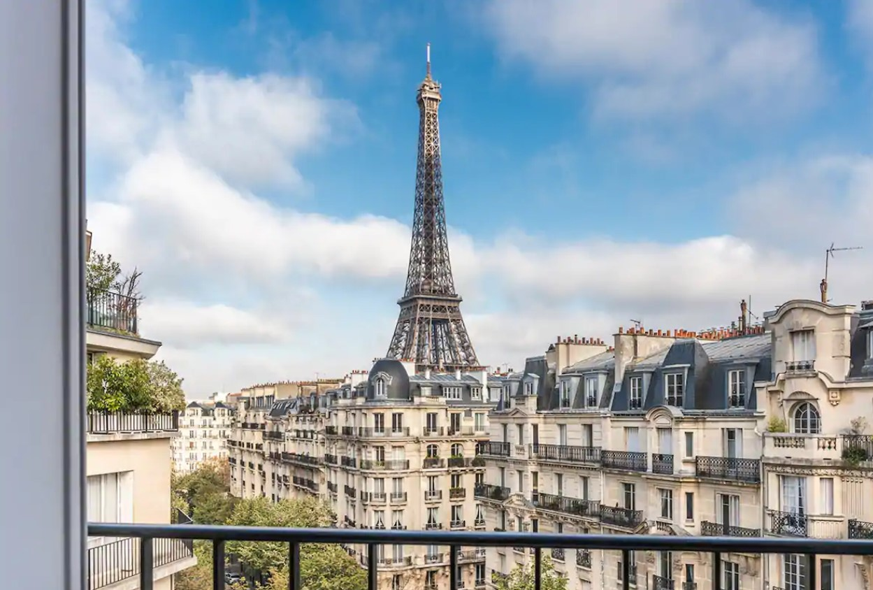 The view of the Eiffel Tower and the streets of Paris from a private balcony in an apartment in Paris