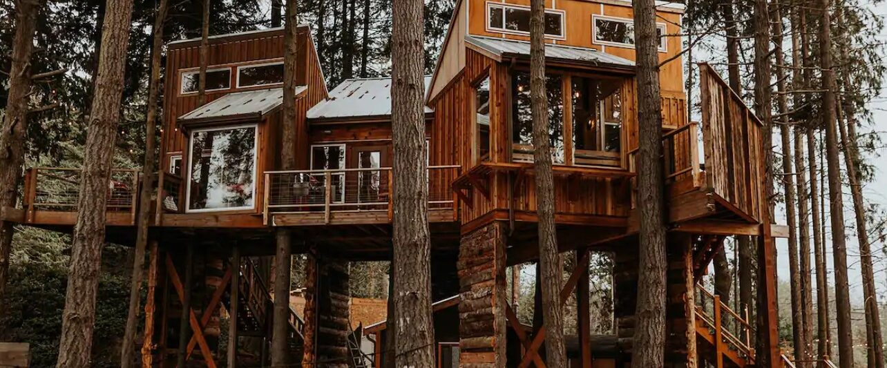 A large treehouse perched in the woods of Washington State