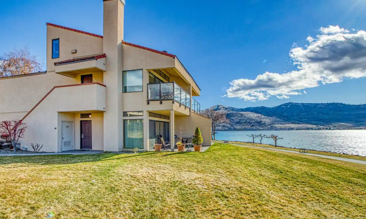 A waterfront condo on Lake Chelan Shores with the Cascade Mountains in the background