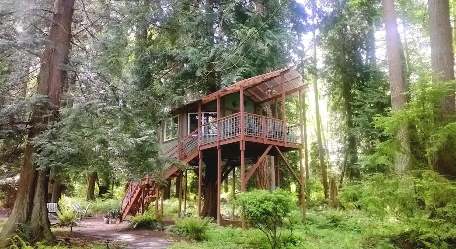 A large treehouse perched in the woods on Whidbey Island Washington