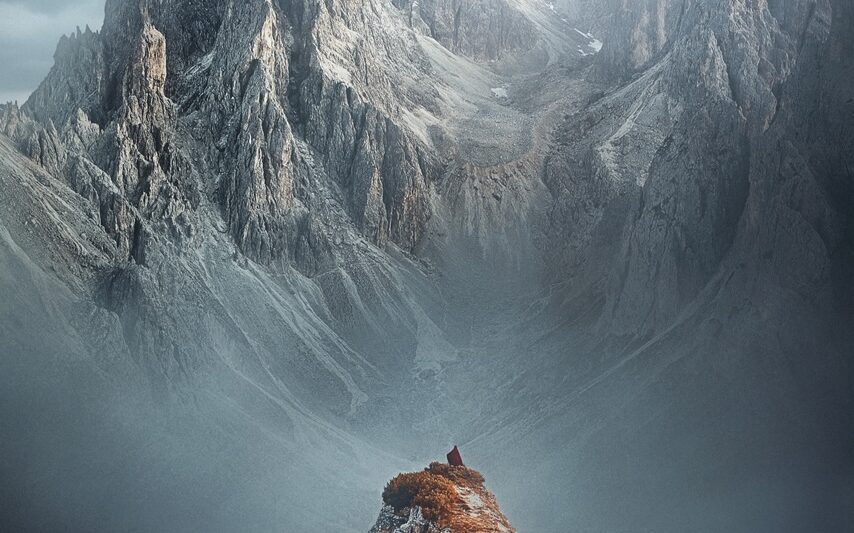 woman standing on top of mountain in italy
