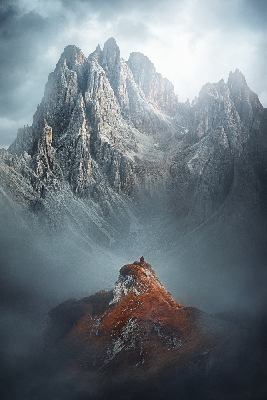 woman standing in mountain scene
