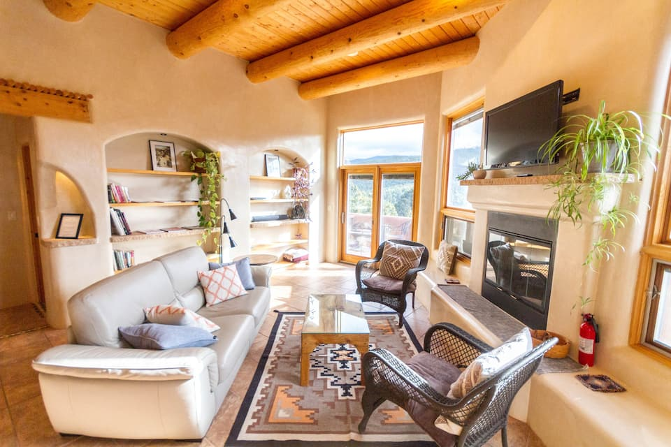 this eco home with amazing mountain views that is close to town is one of the best Airbnbs in Santa Fe