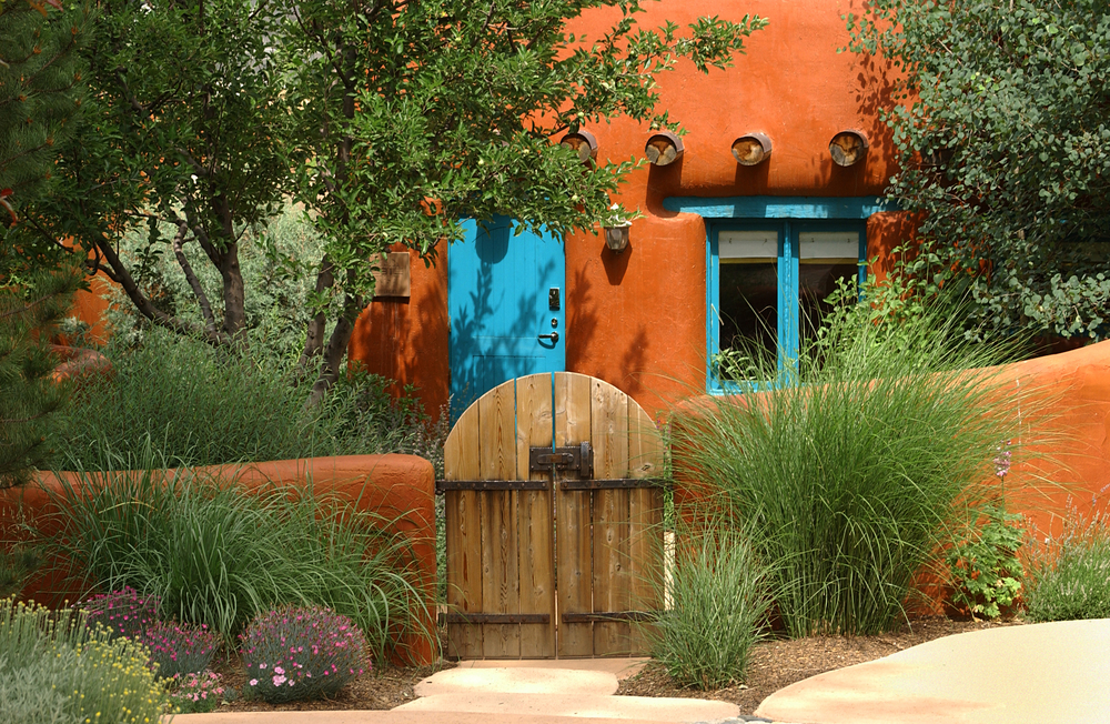 an orange adobe home in the same style of many of the best Airbnbs in Santa Fe