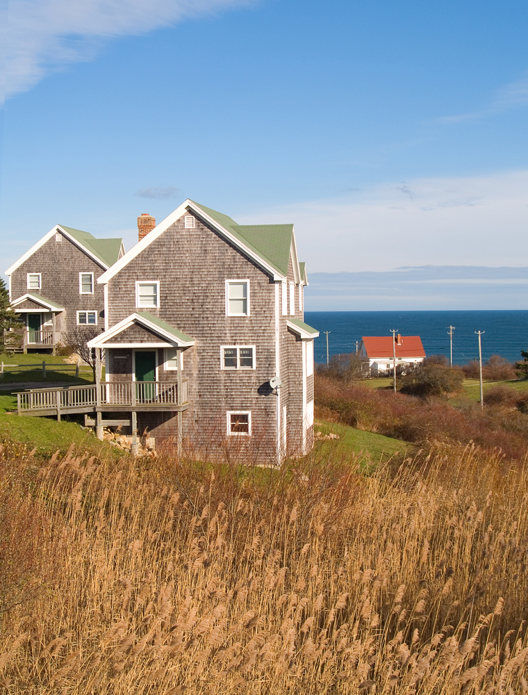 beach homes on the shore of Block Island Rhode Island surrounded by grassy dunes