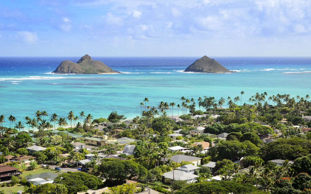 An overhead view of Kailua Hawaii with views out to the ocean and two smaller islands on a sunny day