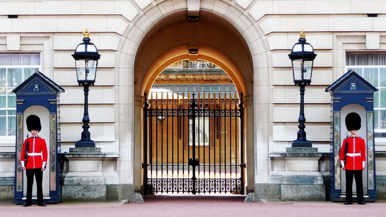 Guards outside a gate at Buckingham Palace in London one of the best ways to spend one week in Europe
