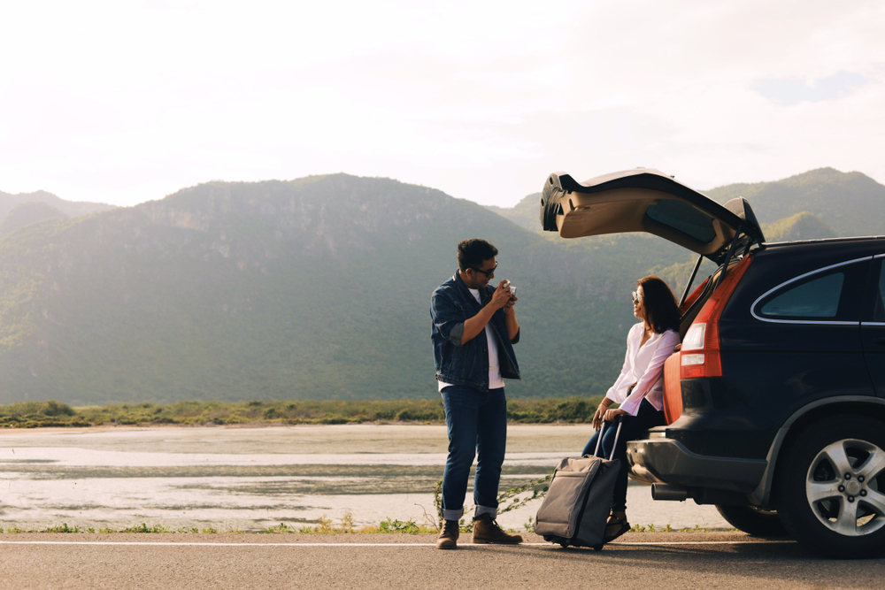 Two people on a road trip stopped having a conversation