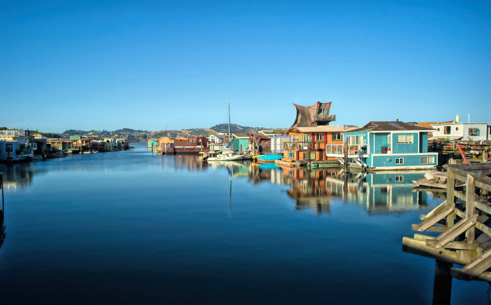 Colorful house boats docked in a marina in Sausalito California best small beach towns in the usa