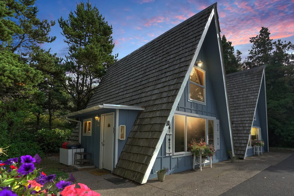 The exterior an A-frame cabin that has been decorated with mid-century design inside that is right near the beach on the Oregon Coast