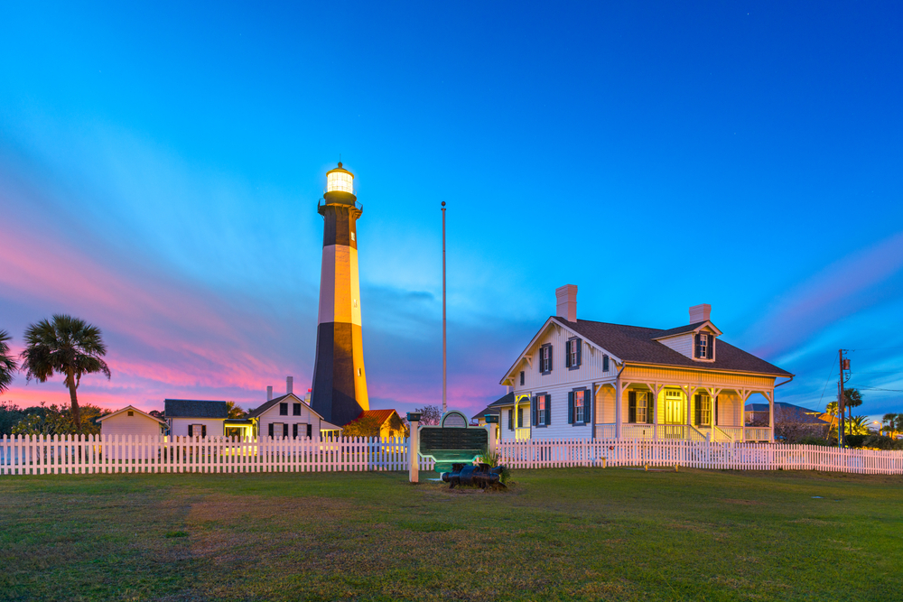 A lighthouse at sunset on Tybee Island in Georgia best small beach towns in the usa