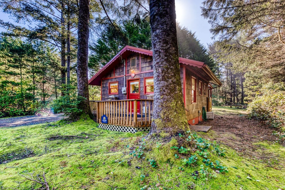 A charming cottage in the woods on the Oregon Coast near the beach, surrounded by trees