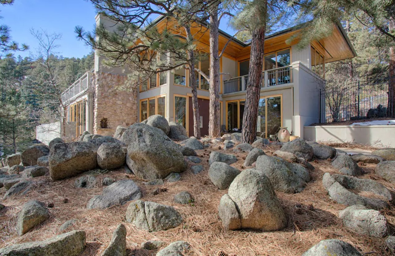 The exterior of a large villa in Boulder Colorado on a sunny day