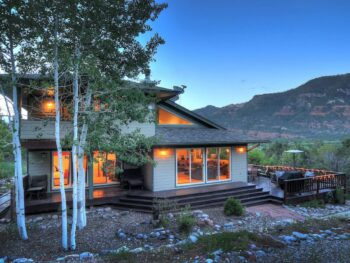 a modern mountain home at twilight VRBO in Colorado