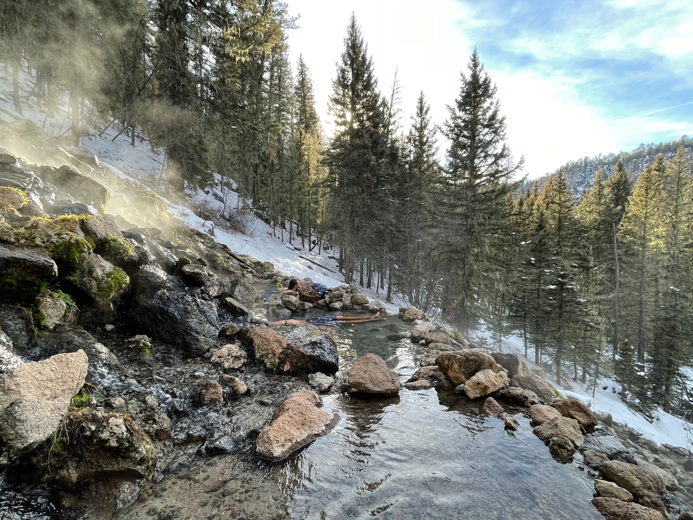 a snowy winter view of San Antonio Hot Springs which is one of the best New Mexico hot springs