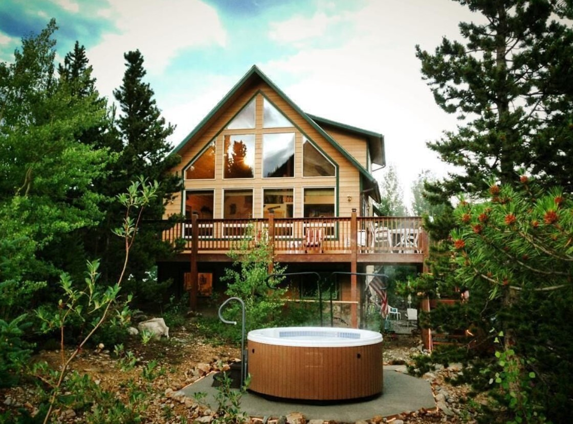 A beautiful A-frame cabin with a large wrap around deck and a hot tub in the yard VRBO in Colorado
