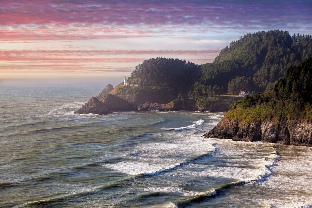 The coast of Oregon with rocky cliffs and calm waves at sunset