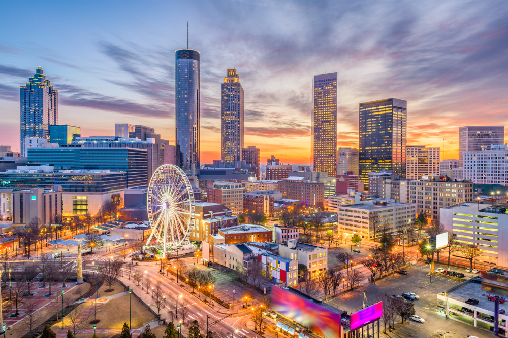 The Atlanta skyline at twilight with the buildings lit up best weekend getaways in the usa