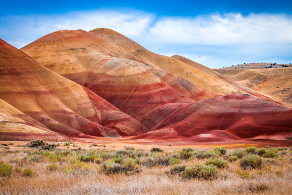 The bright red and orange striped hills of the Painted Hills Overlook Hike.