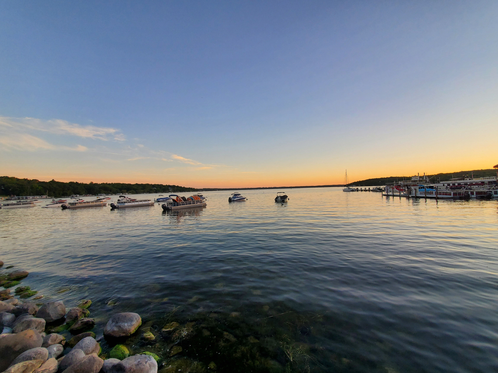 Boats in the water at Lake Geneva at sunset. One of the best bachelorette party destinations.
