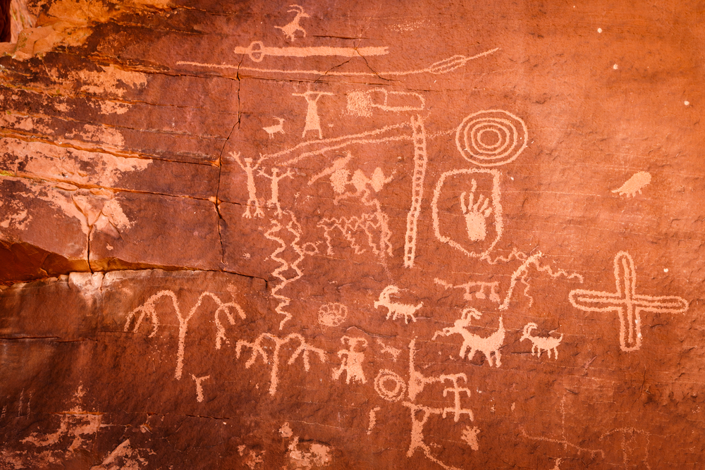 an up close look at the petroglyphs carved into Atlatl Rock including the image of an atlatl