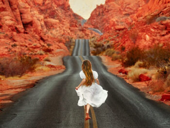 woman running away down street on mouse's tank road in valley of fire state park