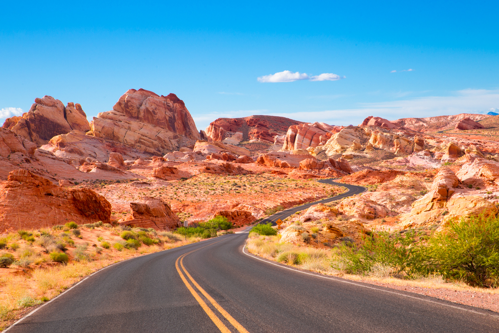 driving through Valley of Fire State Park past the colorful rock formations to reach the main attractions