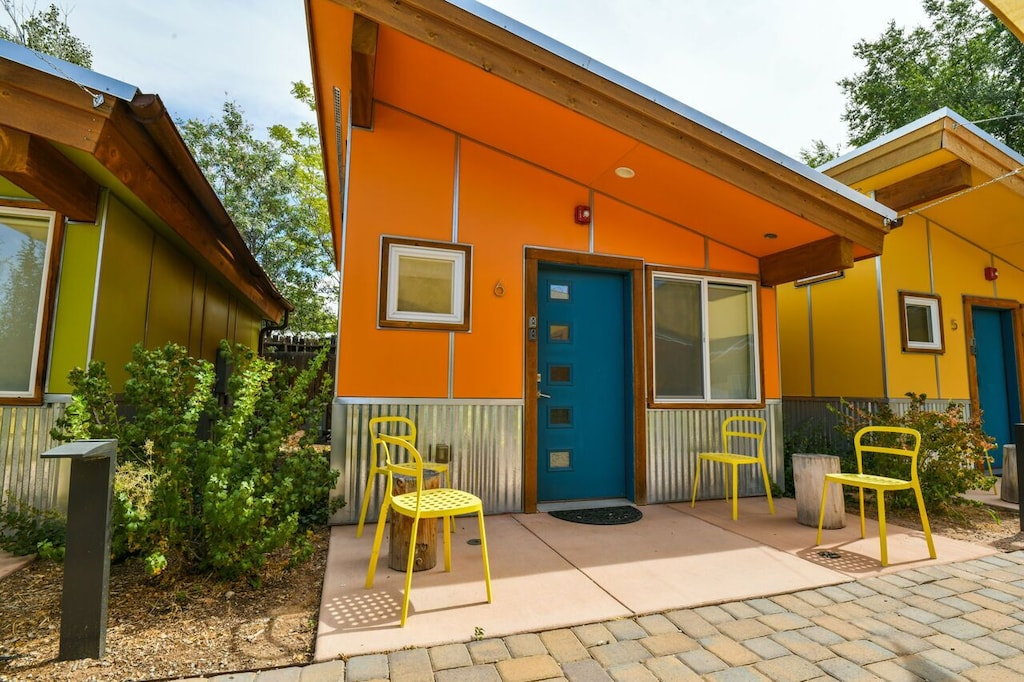 Colorful orange and blue exterior of West 6, one of the best airbnbs in Moab.