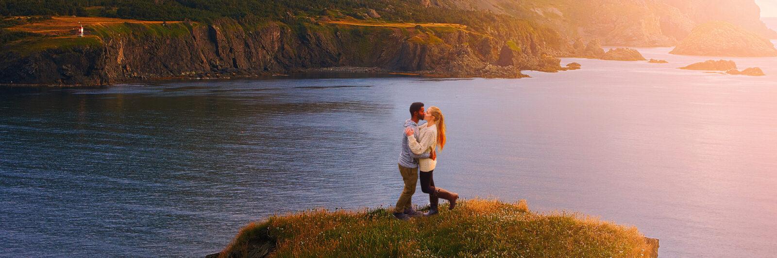 couple kissing on west newfoundland itinerary at sunset